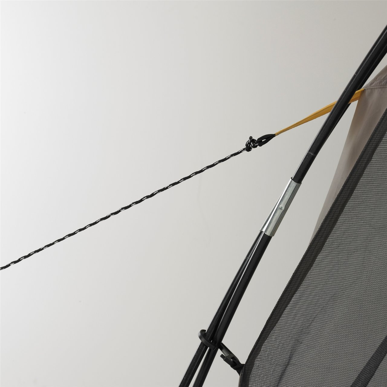 Close up view of a guy line being extended on the Wenzel Sun Valley shelter