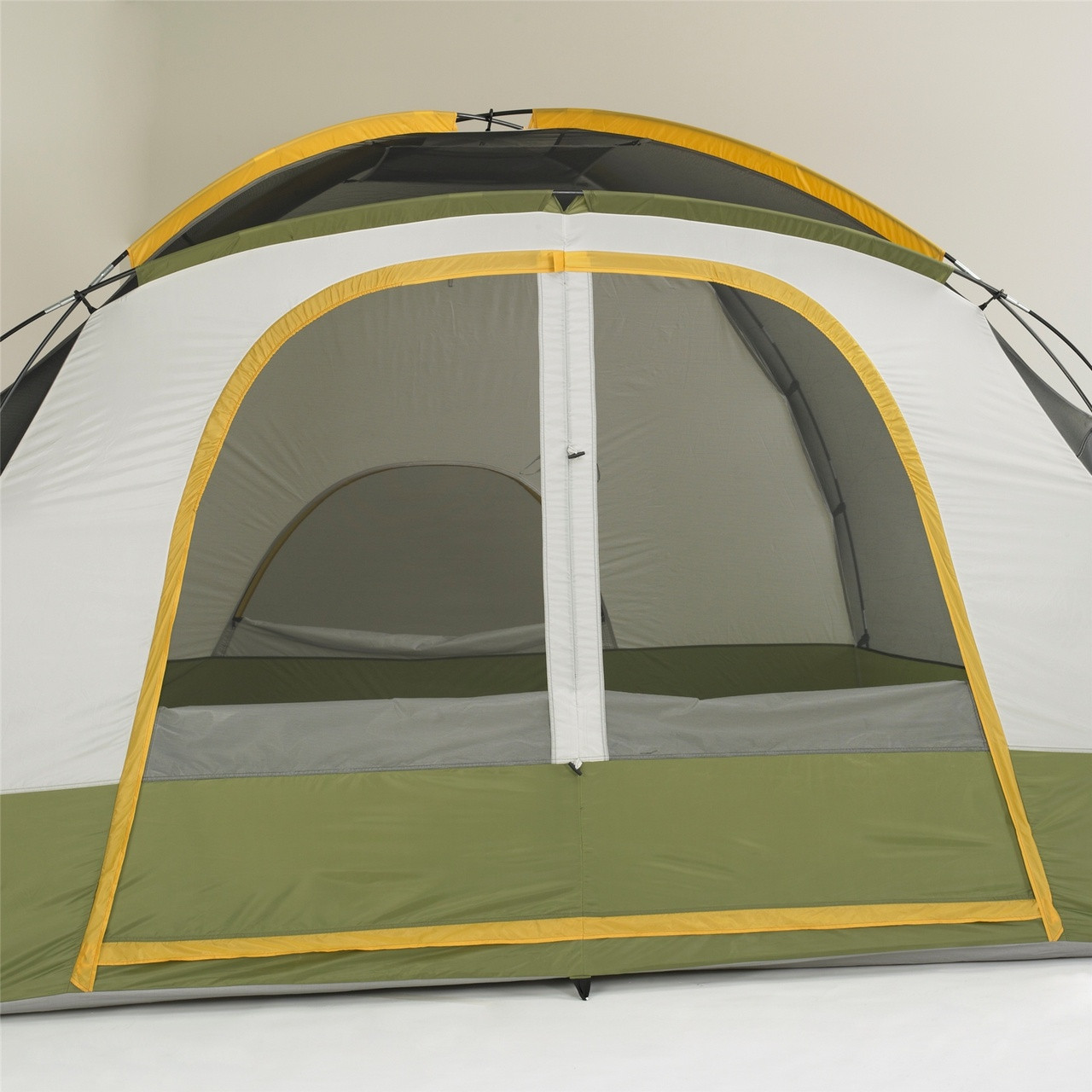 Close up view of the front door on the Wenzel Evergreen 6 tent, green and tan, setup with the rain fly off and the main screen door windows rolled down