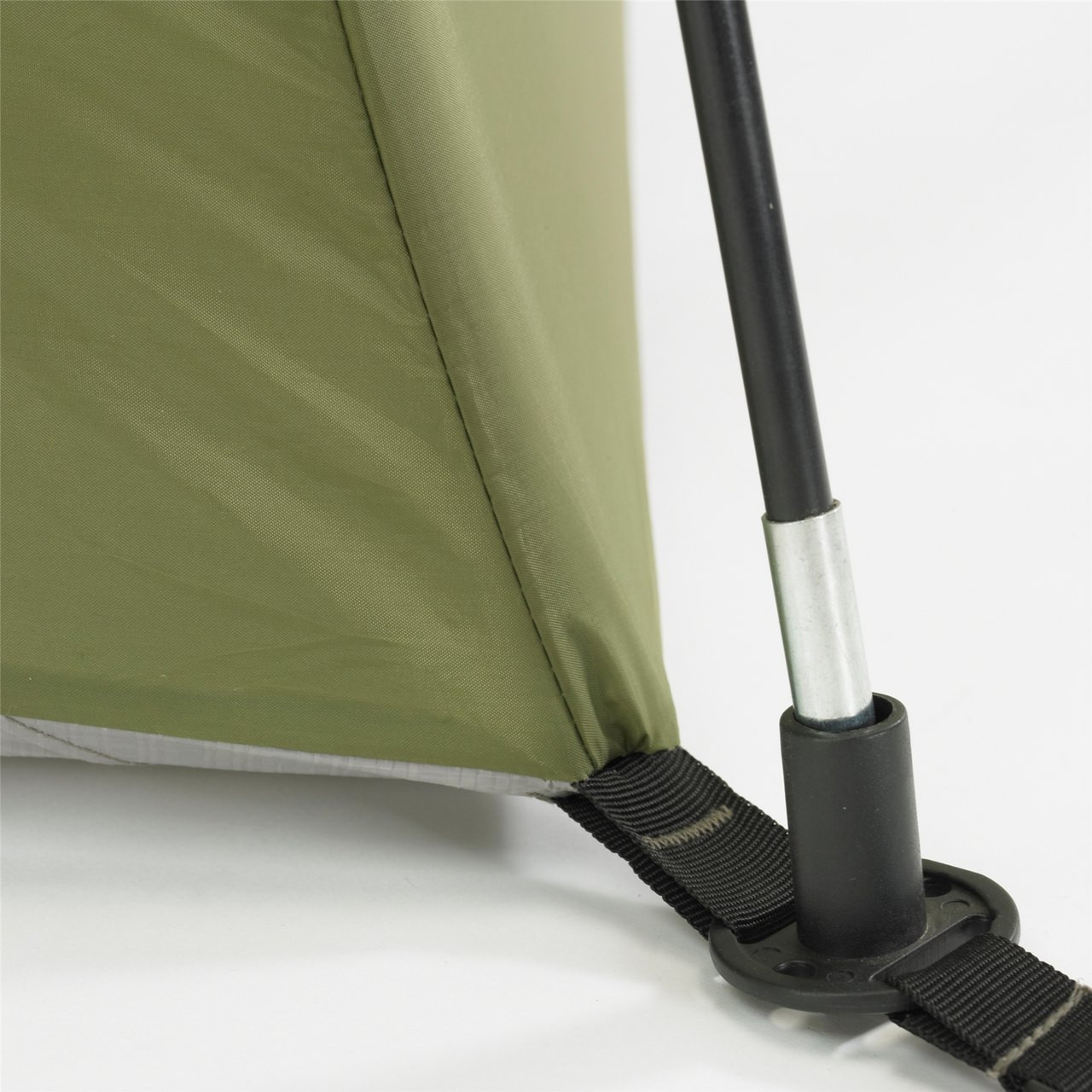 Close up view of a tent pole inserting into a tent pole hub on the Wenzel Evergreen 6 tent