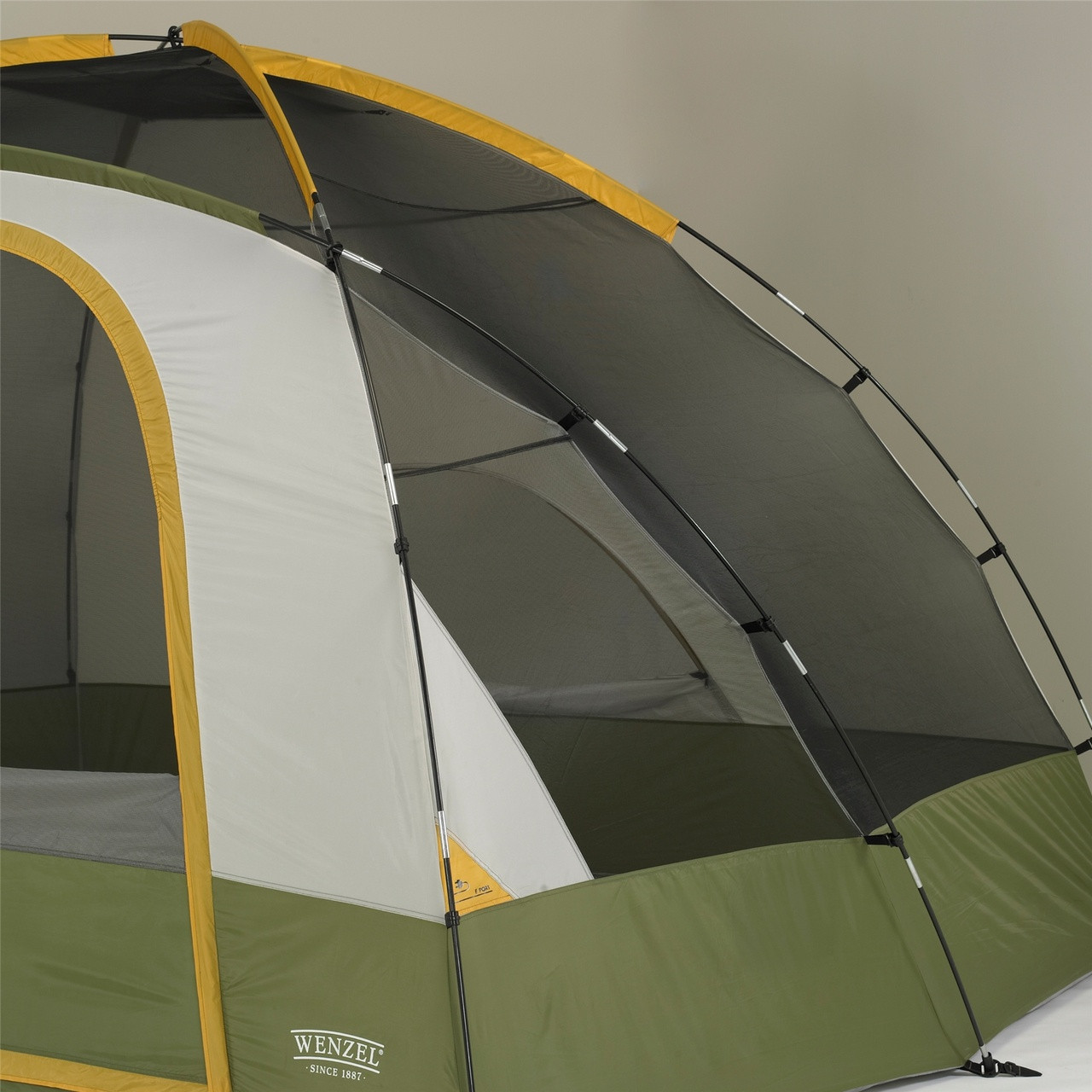 Close up view of the right side poles and tent body on a Wenzel Evergreen 6 tent with the rain fly off