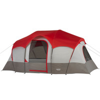 Wenzel Blue Ridge 7 Tent, white and gray, fully set up with a red rain fly on and the guy lines extended with the screen doors open