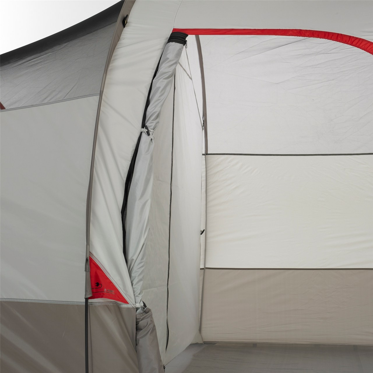 Close up view of the Wenzel Blue Ridge 7 tent, white and gray, with a door rolled closed showing a big interior room of the tent
