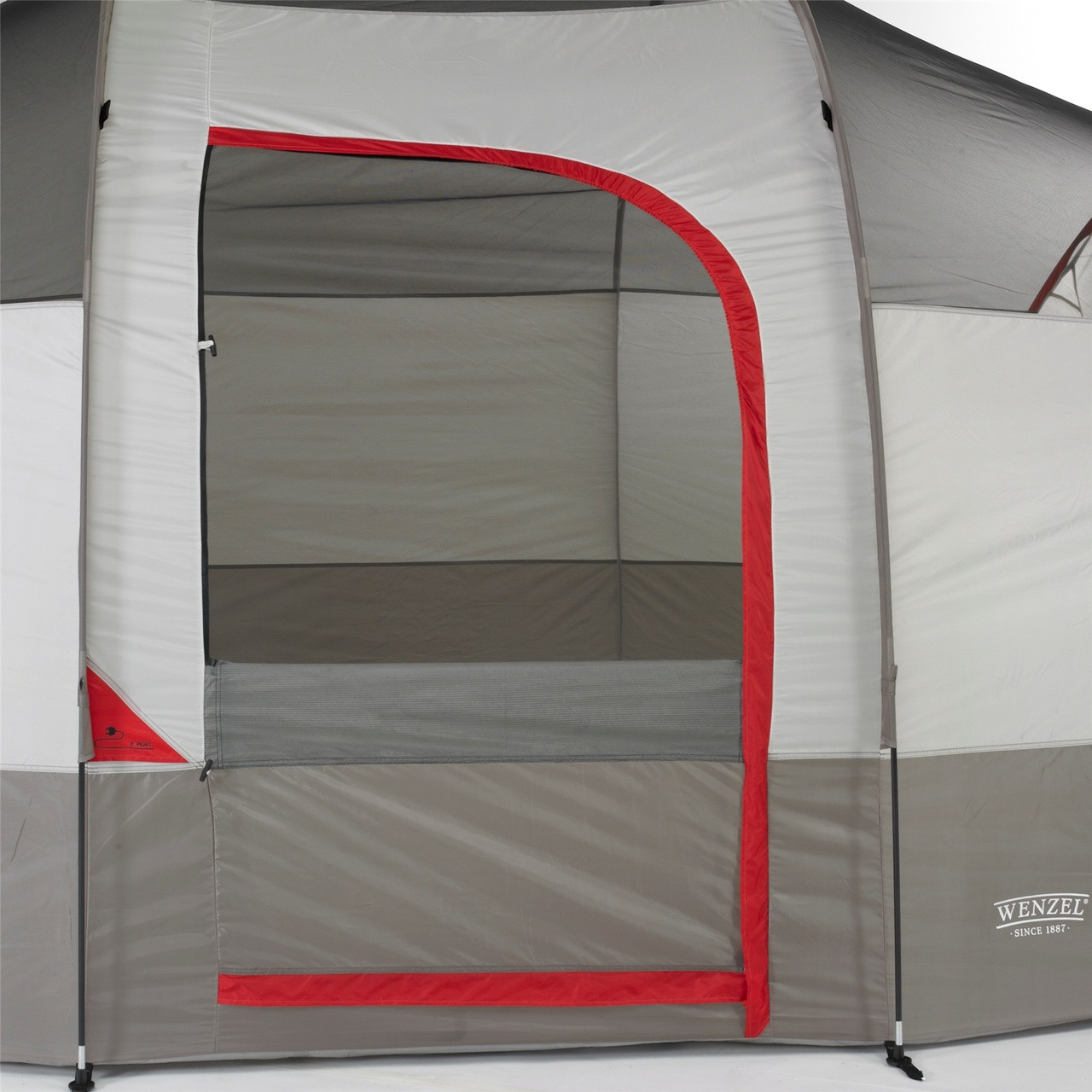 Close up view of the front door on the Wenzel Blue Ridge 7 Tent, gray and white with red accents, with the screen door open showing the interior of the tent