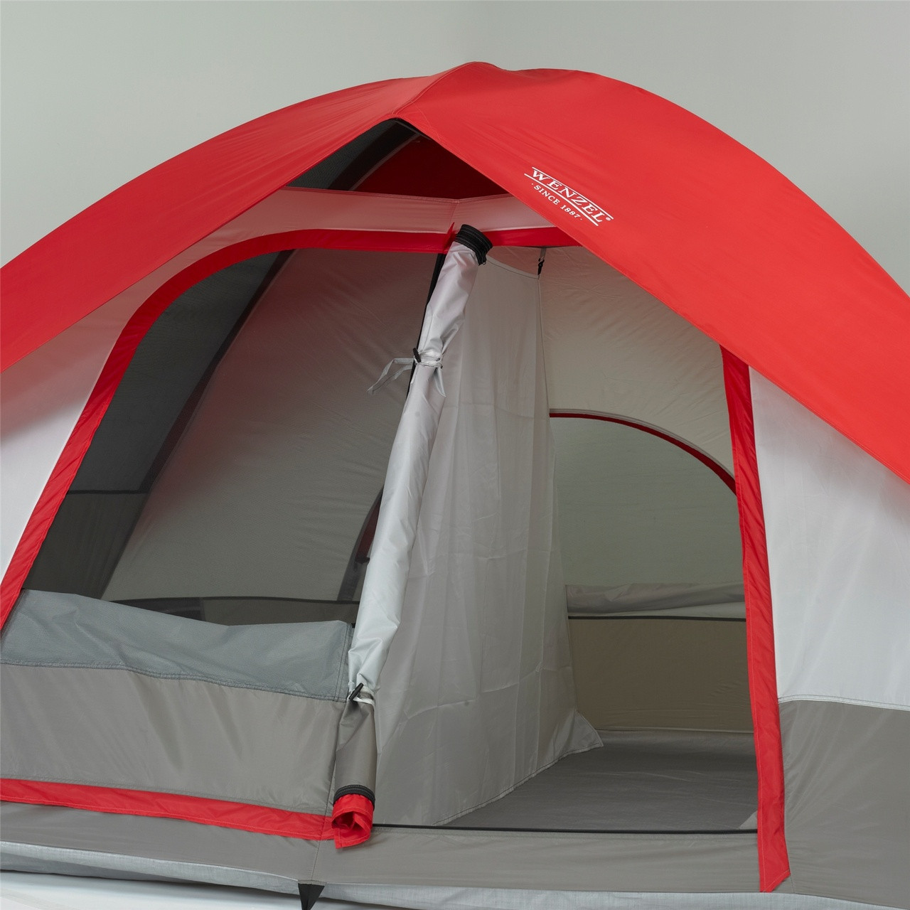 Wenzel Pine Ridge 5 tent, red gray and tan, setup with the rain fly on and the right side main door rolled open with the tent room divider inserted showing half of the tent