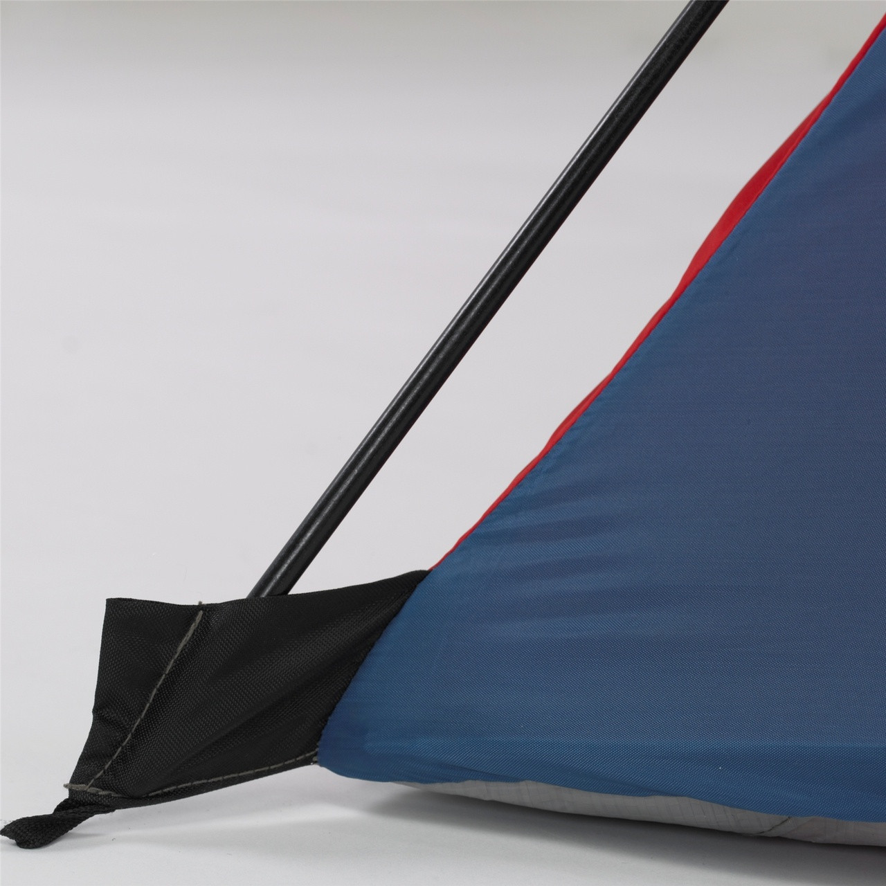 Close up view of a pole connecting to the tent body in the pole insertion hub on a corner of the Wenzel Sprout 2 tent