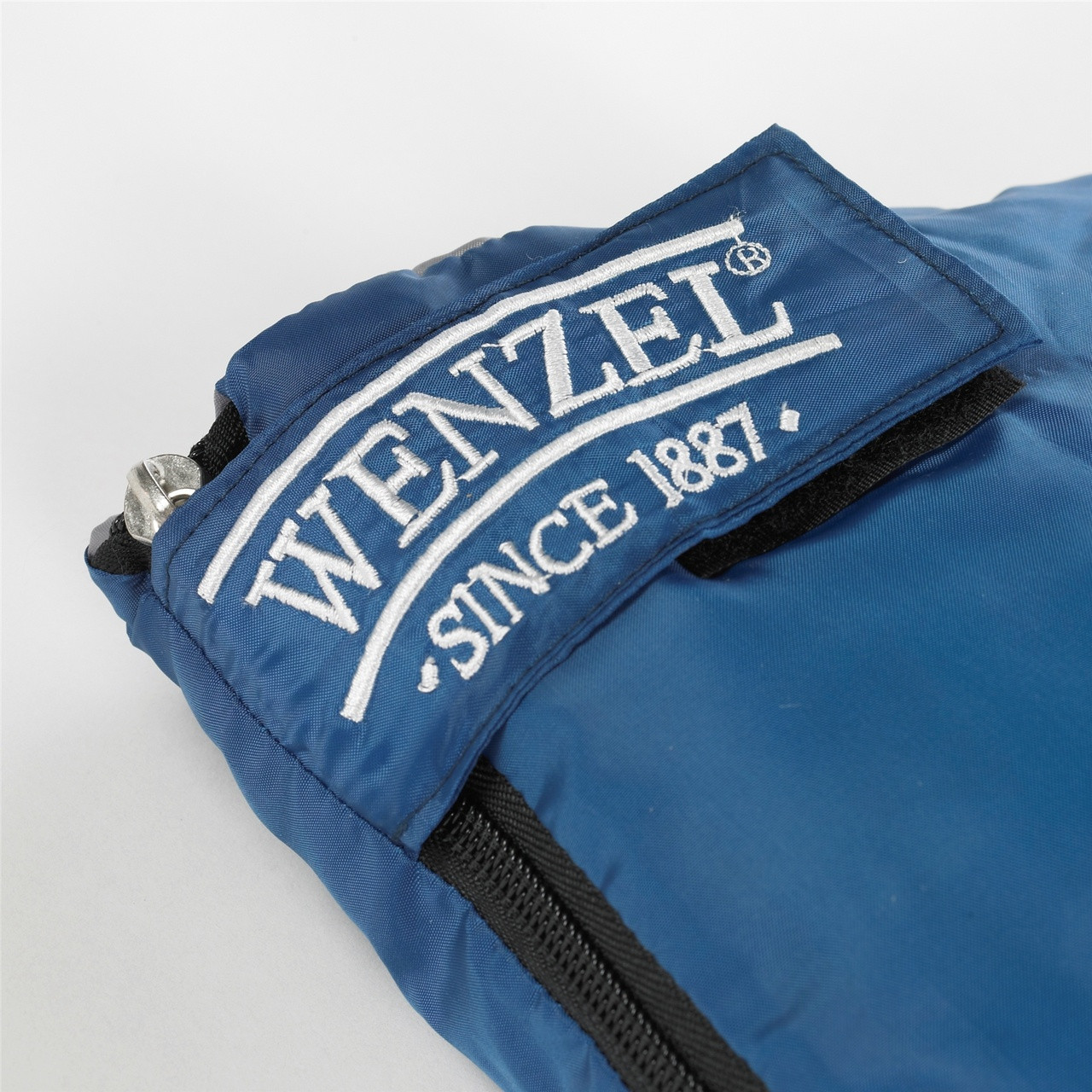 Close up view of the zipper latch on the Wenzel Sunward 30 degree sleeping bag showing 'Wenzel since 1887' text