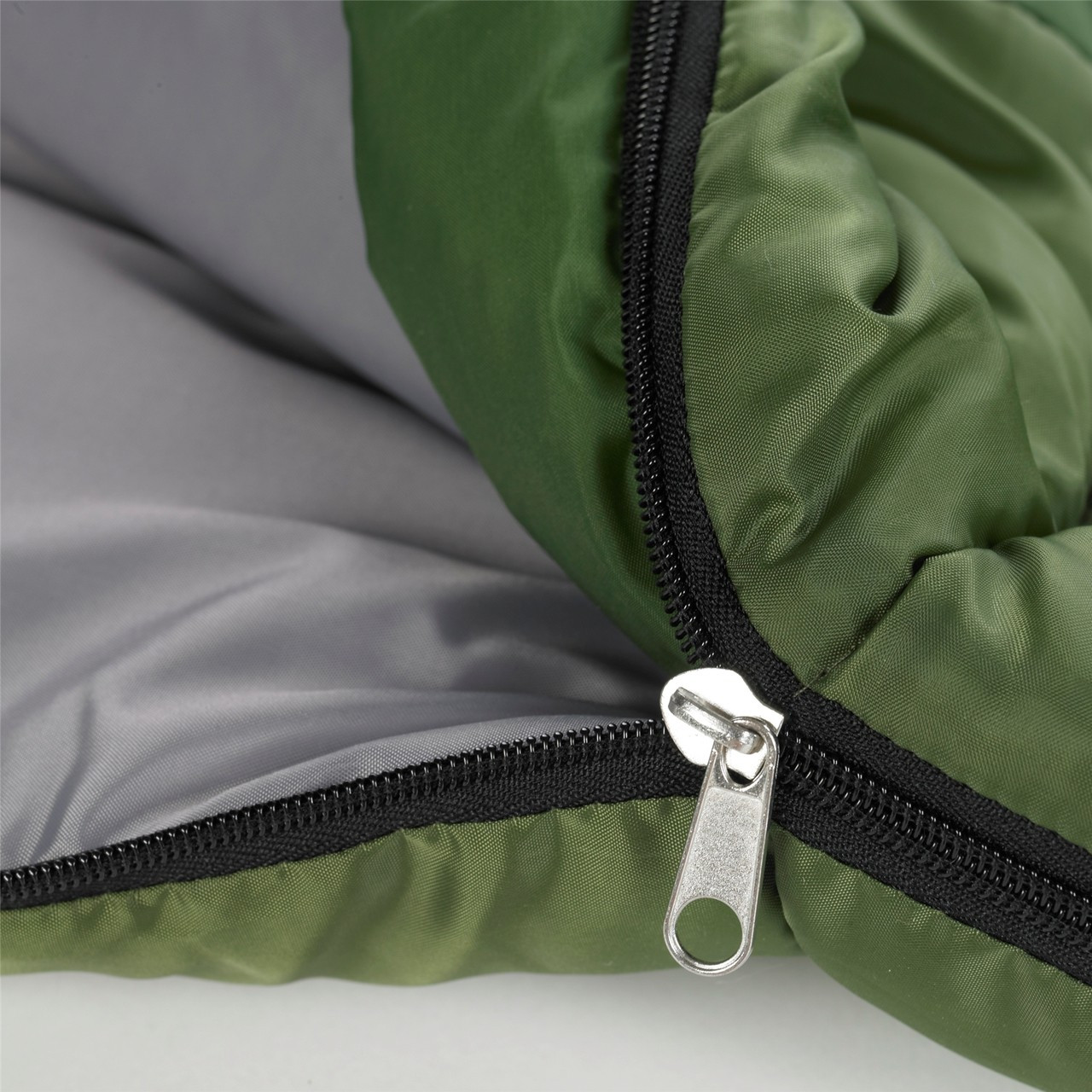 Close up view of the zipper partially unzipped on the Wenzel Kids backyard 30 degree sleeping bag, green