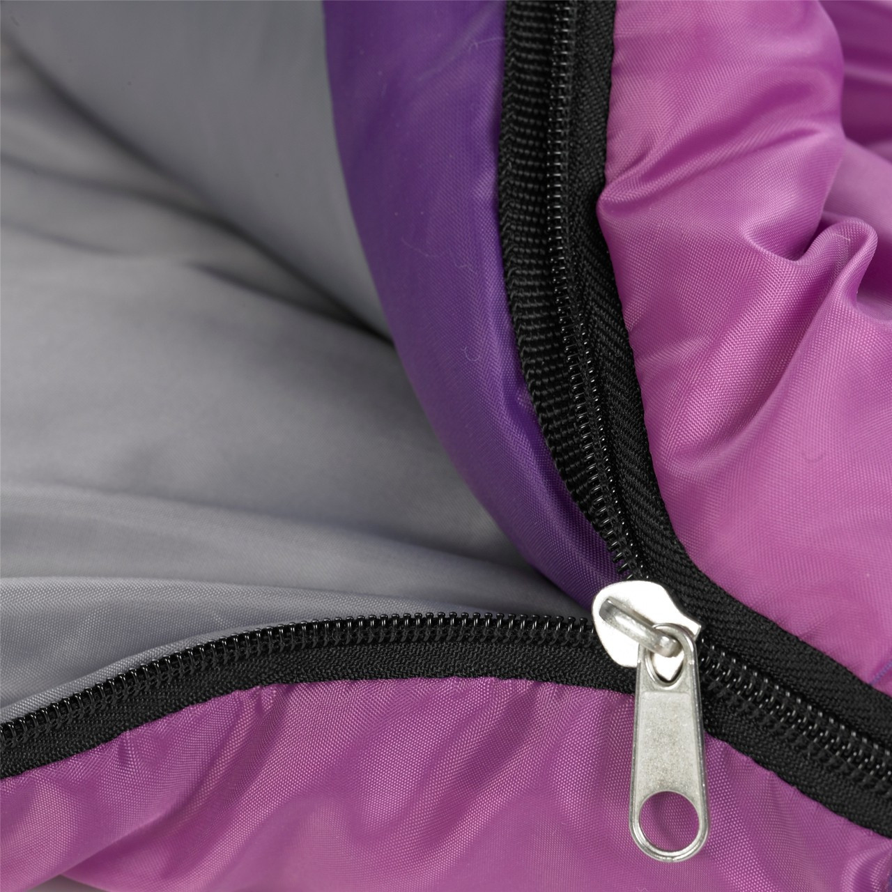 Close up view of the zipper partially unzipped on the Wenzel Kids Backyard 30 degree sleeping bag, purple