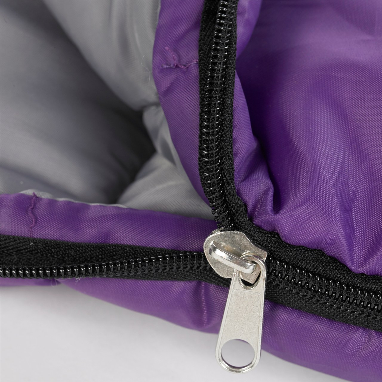Close up view of the zipper partially unzipped on the Wenzel Kids Summer Camp 40 degree sleeping bag, purple