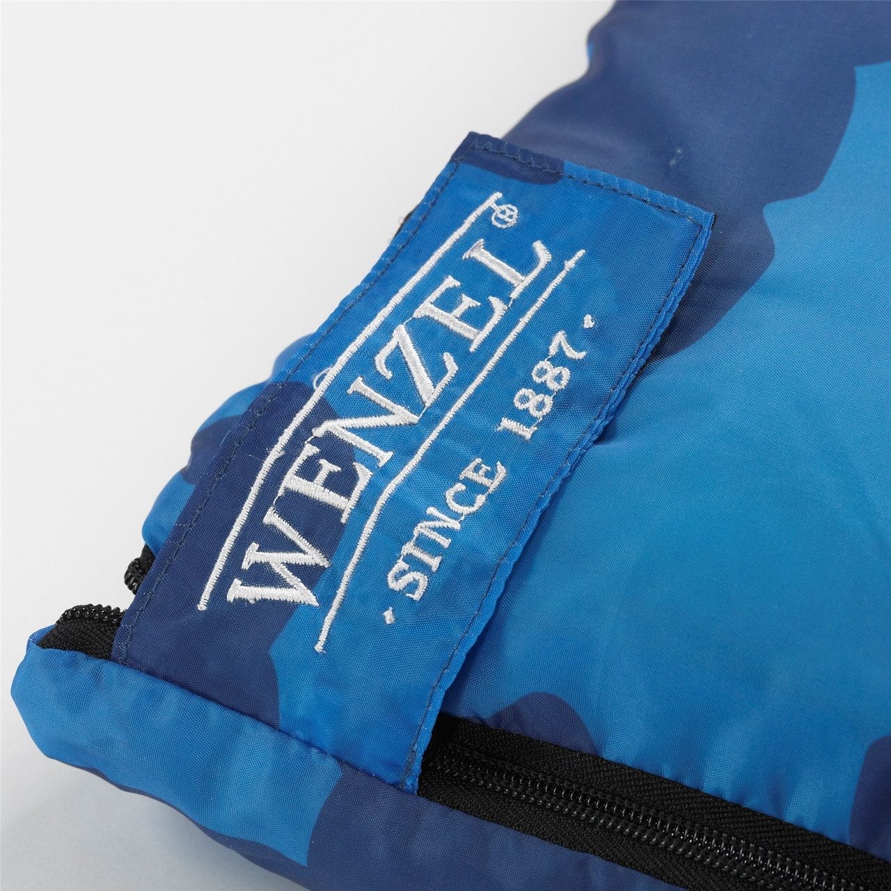 Close up view of the Velcro latch over the zipper on the Wenzel Kids Blue Moose 40 degree sleeping bag