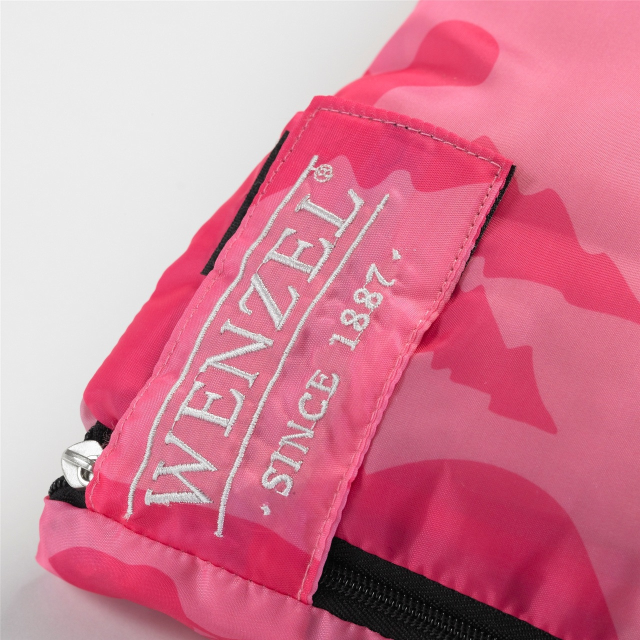 Close up view of the Velcro latch over the zipper on the Wenzel Kids Pink Moose 40 degree sleeping bag
