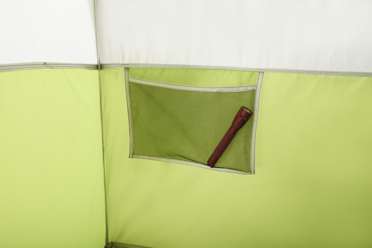 Close up view of an inside mesh pocket in the Wenzel Eldorado 8 tent storing a flashlight