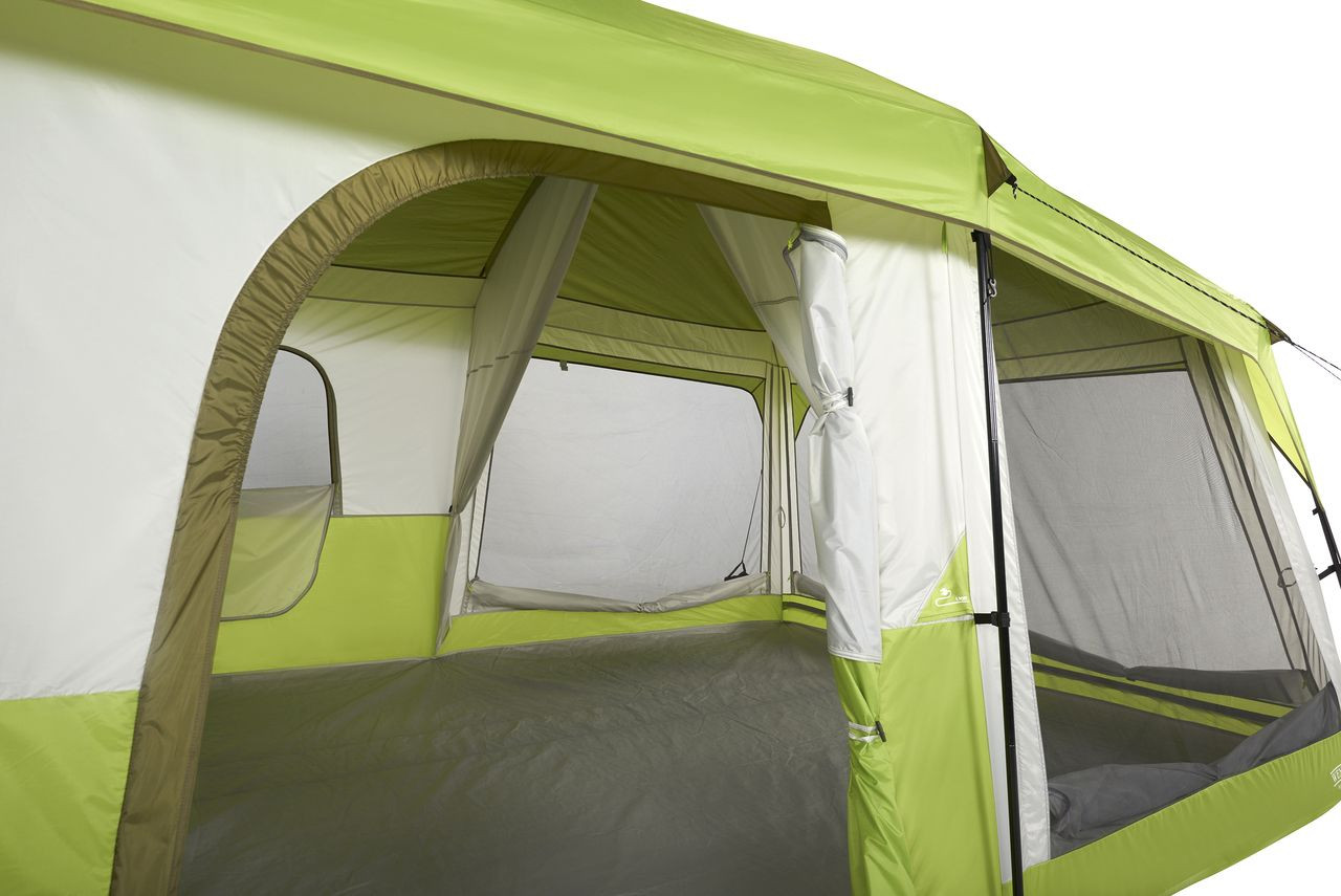 Close up view of the Wenzel Eldorado 10 tent, light green and gray, set up with the rain fly on, guy lines extended, and the main door rolled open