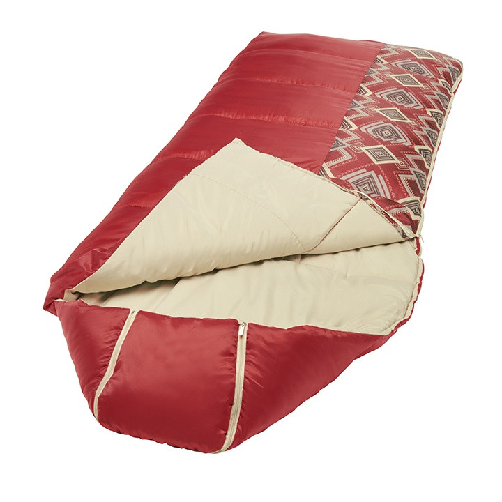 Wenzel Pop-Top sleeping bag laying flat with the corner partially unzipped and folded over showing the tan interior of the sleeping bag