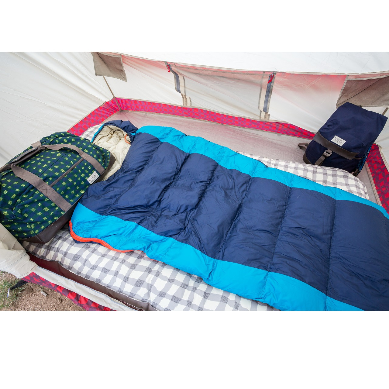 Wenzel Jailbird sleeping bag laying on top of a Wenzel air mattress inside a Wenzel tent next to a Wenzel duffel bag and tent
