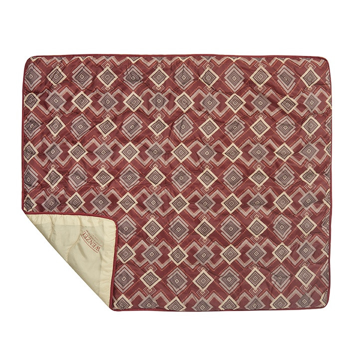 Wenzel Camp Quilt, red gray and white, square pattern, laying flat with part of a corner folded over showing the tan underside