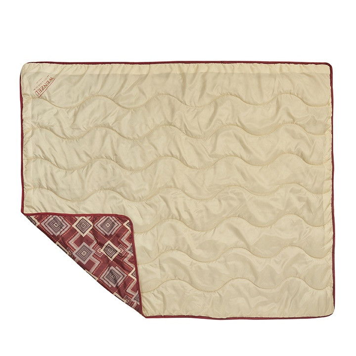 Wenzel Camp Quilt, red gray and white square pattern, laying flat with the tan underside up with part of the corner folded over showing the red top side of the quilt