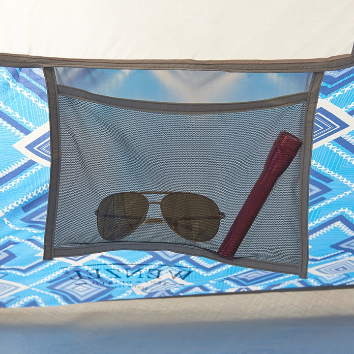Close up view of a pair of sunglasses and flashlight stored inside of a mesh pocket inside of the Wenzel Shenanigan 8 tent