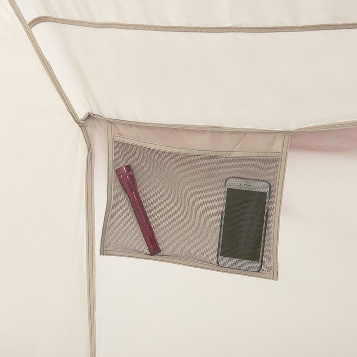 Close up interior view of a storage pocket inside of a Wenzel Ballyhoo 4 Tent showing a flashlight and iPhone stored