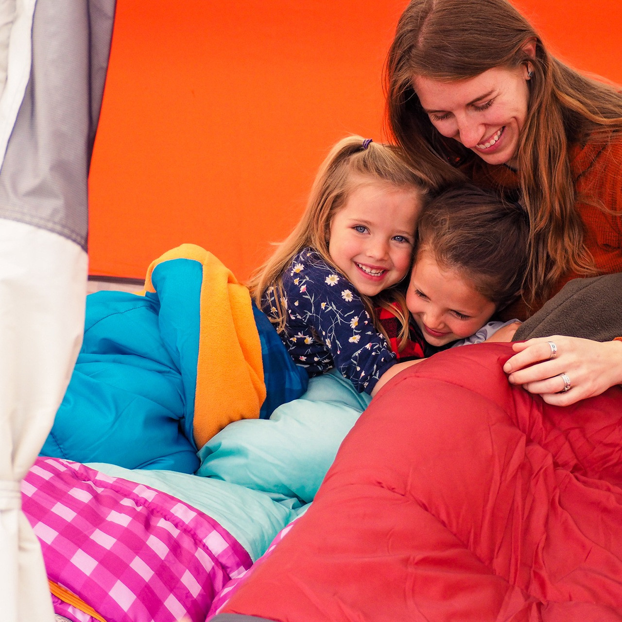 Family with Wenzel Sapling Youth Sleeping Bag, in a tent