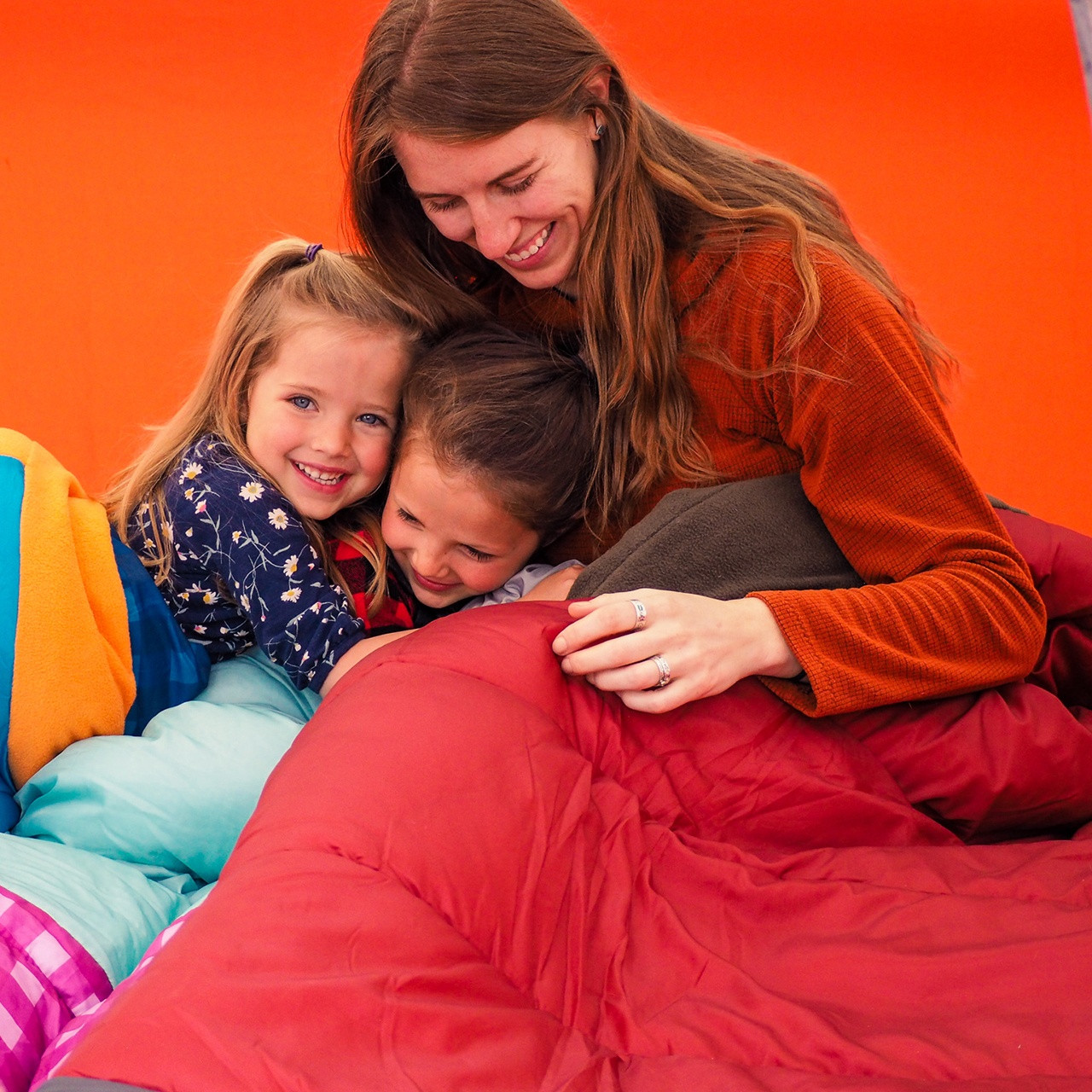 Family with a Wenzel Lodgepole Sleeping Bag, in a tent