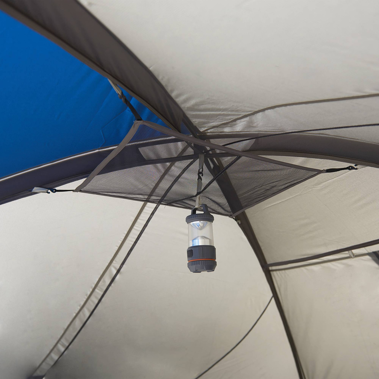 Interior of Wenzel Pinyon 10 Person Dome Tent, blue/white, showing lantern hanging from ceiling