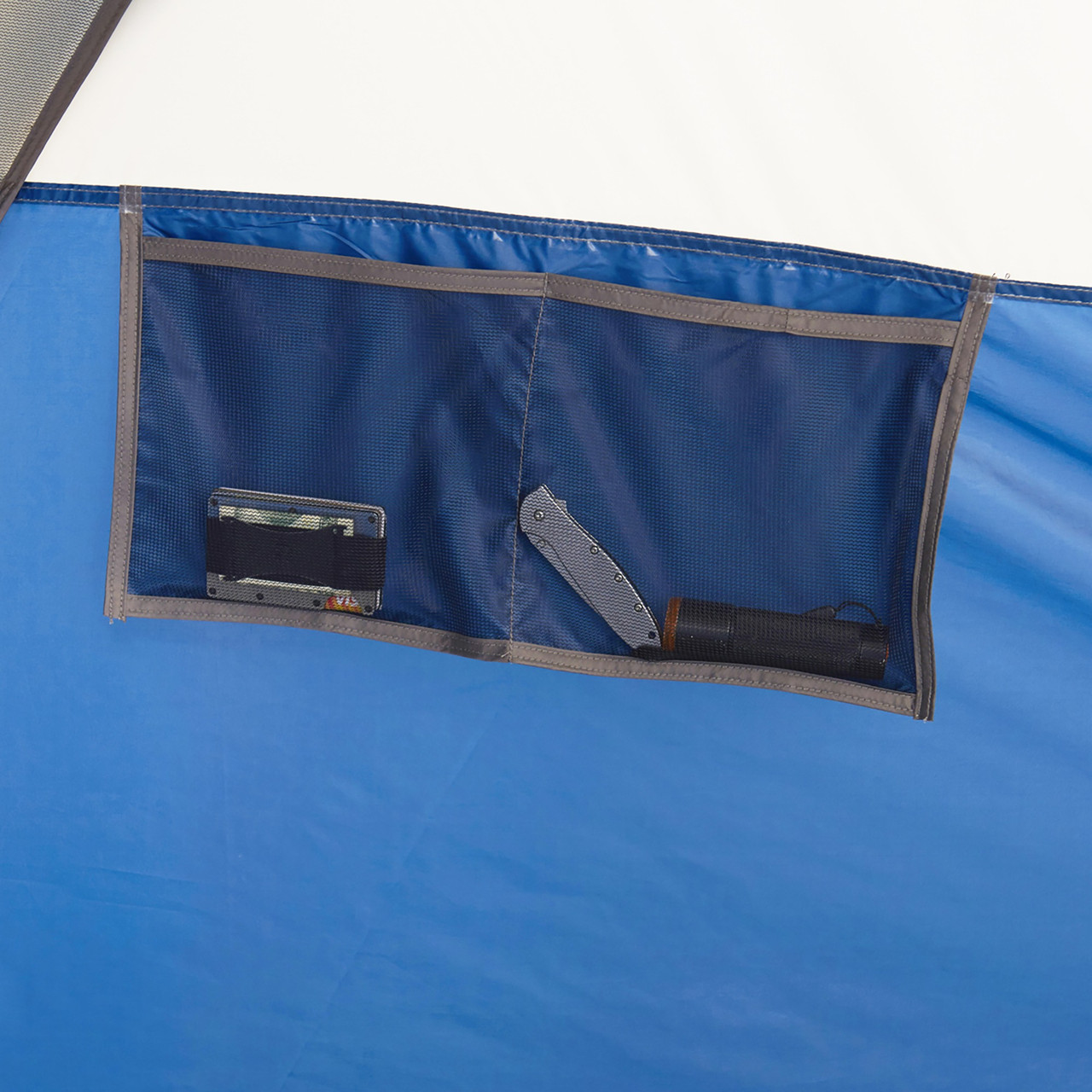 Interior of Wenzel Pinyon 10 Person Dome Tent, blue/white, showing hanging accessory pocket