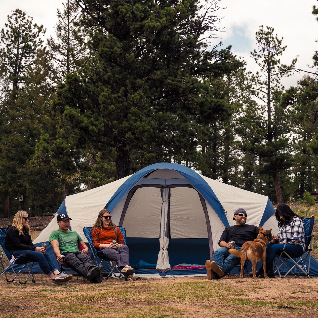 Group of campers in front of tent