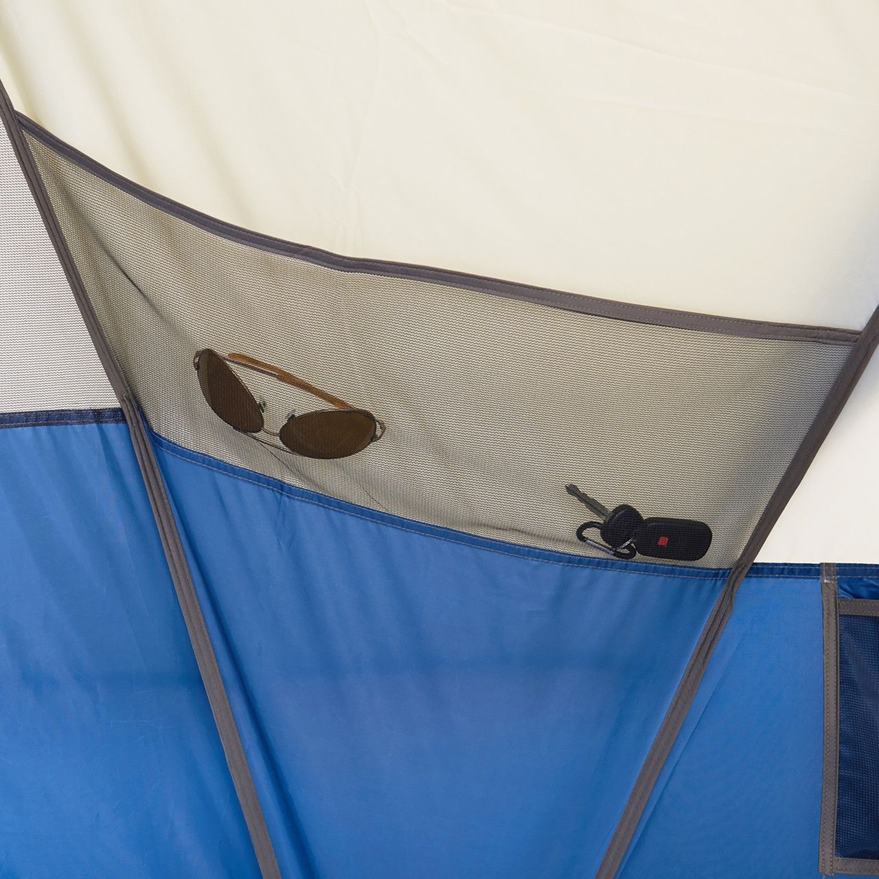 Interior of Wenzel Pinyon 10 Person Dome Tent, blue/white, showing mesh pocket