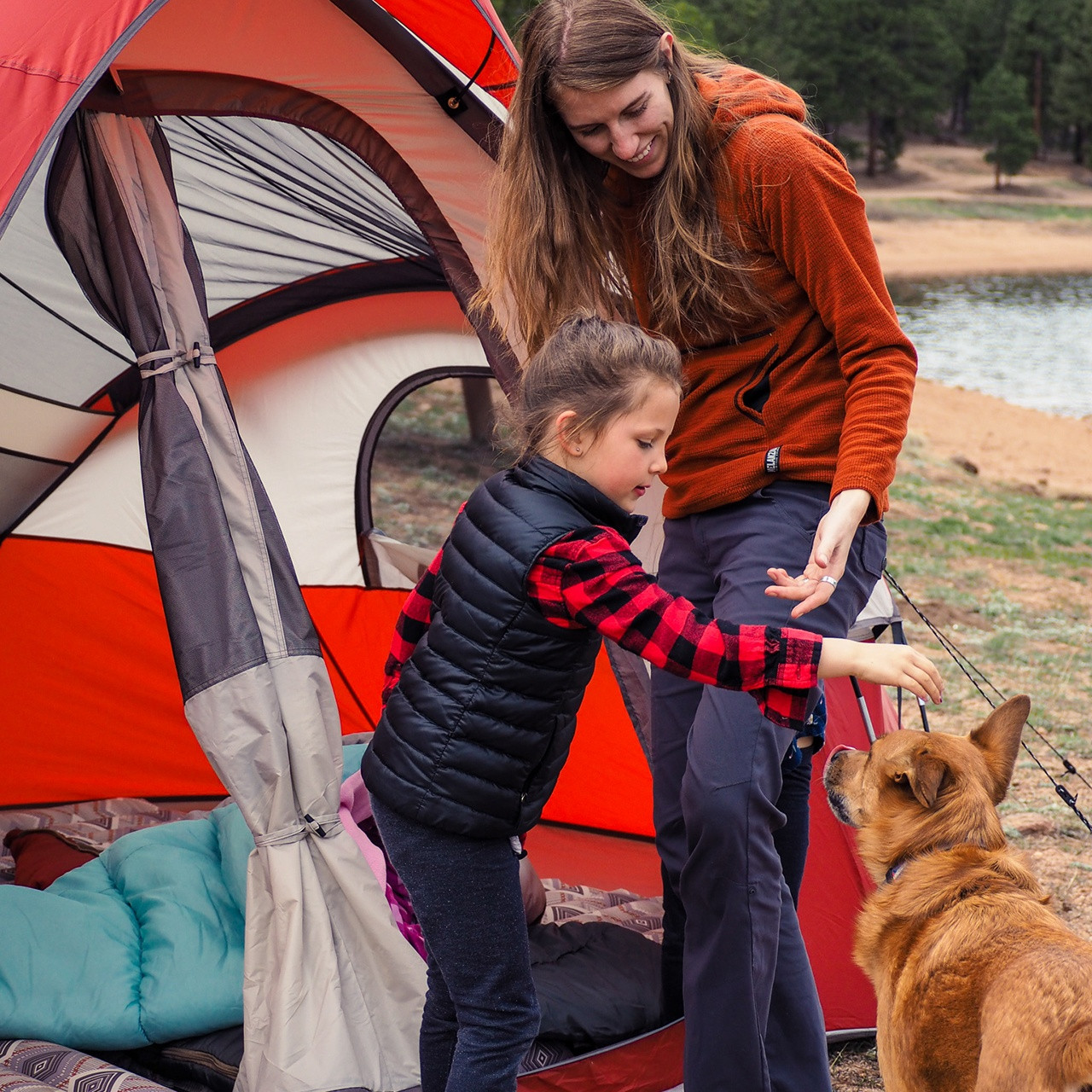 Woman and child with a dog and their Wenzel Bristlecone 8 Person Dome Tent