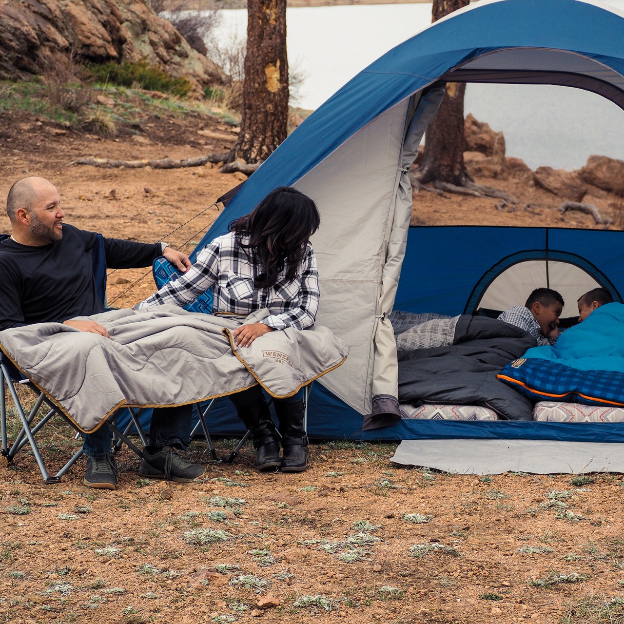 Campers with their Wenzel Tamarack 6 Person Dome Tent in the woods