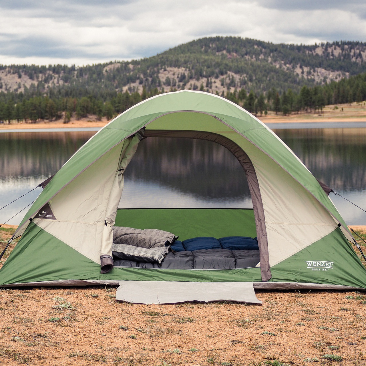 Wenzel Jack Pine 4 Person Dome Tent, shown pitched in front of a lake