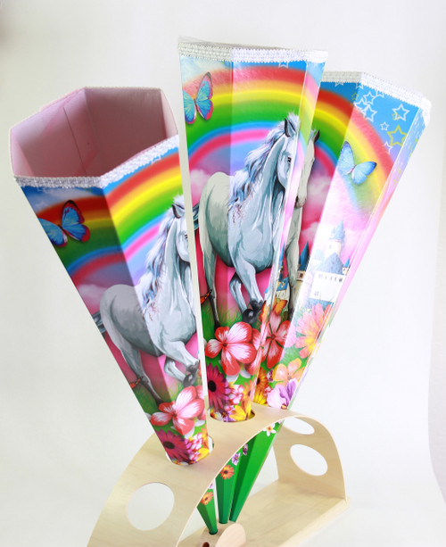 A white horse in front of a colorful rainbow and a lot of flowers are the leading images in this girlie Kidscone