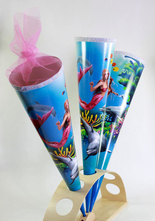 Schultüten or KidsCone are a very common and old tradition in germany / austria. This motive with the mermaid is coming a huge success with girls since disney featured a mermaid in one of his movies.