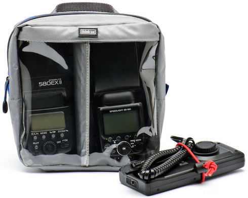 This large camera accessory bag perfectly fits two pro size flashes, large battery packs, and microphones