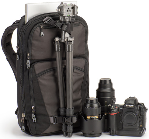External tripod attachment on front of bag keeps tripod weight centered.