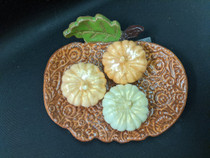 Pumpkins in ceramic pumpkin soap dish