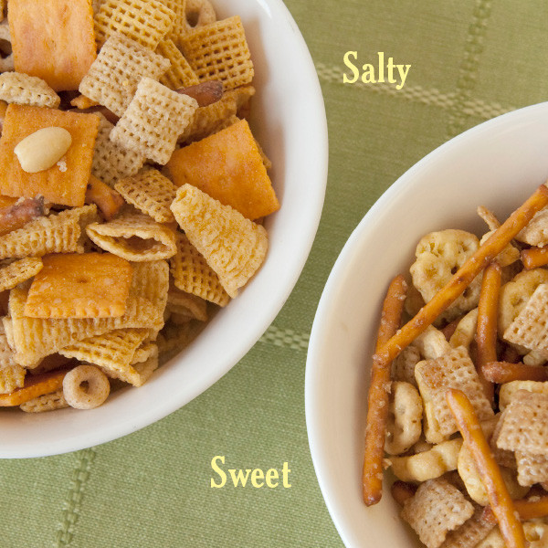 You won't believe how quickly this snacker's delight will disappear. Made in our own bakeries, our Salty variety contains bugles, cheese crackers, chex cereal, peanuts, pretzels and cheerios and is lightly coated and baked with a delicious flavoring. Available in 8 oz tubs. Our Sweet-n-Salty mix contains honeycomb cereal, pretzels, chex cereal baked in a sweet honey-based flavoring.  Available in 5oz tubs.