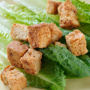 The same croutons as we serve in our restaurants, our homeade croutons are made using our own homemade bread and toasted to perfection with our own blend of flavorings and spices.  Available in a one quart tub.