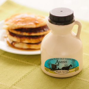 """""""Maple syrup, long used by Native Americans and pioneers alike, is a natural, healthy sweetener produced by boiling the sap of maple trees - it contains vitamins, minerals and amino acids. Our syrup is produced at Miller's Sugar Camp in the Amish community in West Salem, Ohio. You'll find maple syrup to be sweeter than sugar with a flavor that cannot be matched by sugar-based pancake syrups. Try it on your pancakes or waffles or use it for baking.  U.S. Grade A Amber Rich Taste. Available in half-pint (8 fluid oz)"""""""
