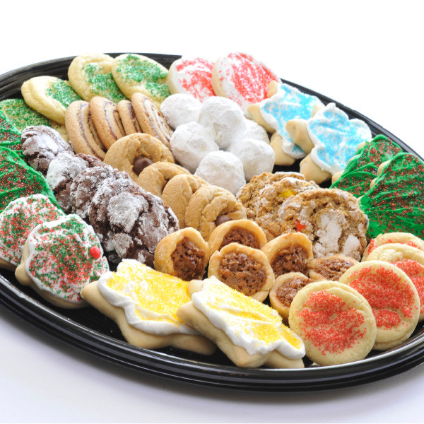 No time to bake for your holiday party or family gathering? Let our experienced Amish bakers help you! Our homemade cookie trays are assembled, carefully wrapped and ready to serve. Assorted Christmas Cookies -  12 inch tray - Assorted Tray      12 Christmas cut-outs     3 white sugar     3 peanut butter blossoms     3 date pinwheels     3 Russian tea balls     2 chocolate crinkles     2 monster cookies     2 pecan tarts   Also available in all Christmas cut-out cookies.  16 inch tray - Assorted Tray      14 Christmas cut-outs     4 white sugar     4 peanut butter blossoms     4 date pinwheels     4 Russian tea balls     4 chocolate crinkles     4 monster cookies     4 pecan tarts   Also available in all Christmas cut-out cookies.