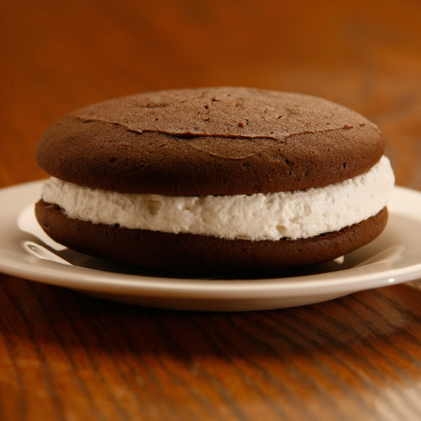 """Are whoopie pies a pie, cake or cookie? We'll let you decide - our chocolate cookie sandwiches are made with rich dark chocolate cake """"cookies"""" and filled with sweet, light and fluffy filling. Also called """"gobs"""" in some areas, chocolate whoopie pies are a delightfully addicting treat.  Cookies are approximately three inches in diameter. Homemade in Ohio's Amish Country."""