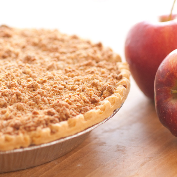 """Liberally blended with cinnamon, sweet apples are cooked into a simple but delicious filling then baked in our homemade pie crusts. No artificial flavorings and colorings are used. Generously topped with crumbs for the """"Dutch"""" flair. Pies will arrive pre-baked and frozen in an insulated shipping cooler. Simply thaw in the oven and your home will be filled with the sweet scent of our Amish bakery. Instructions are included. Baked and shipped from Ohio's Amish Country.   Available as a 9 inch pie. We do not use high-fructose corn syrup to make our fruit pie fillings."""