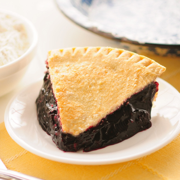 No offense to red raspberries, but black raspberries naturally have more flavor (and seeds) than red raspberries. Enjoy the intensity of the tart, yet sweet flavor in our homemade black raspberry pie. Our Amish double-crusted fruit pies are lightly brushed with butter and sprinkled with sugar to brown the crust.  Pies will arrive pre-baked and frozen in an insulated shipping cooler. Simply thaw in the oven and your home will be filled with the sweet scent of our Amish bakery. Baked and shipped from Ohio's Amish Country.   We do not use high-fructose corn syrup to make our fruit pie fillings.