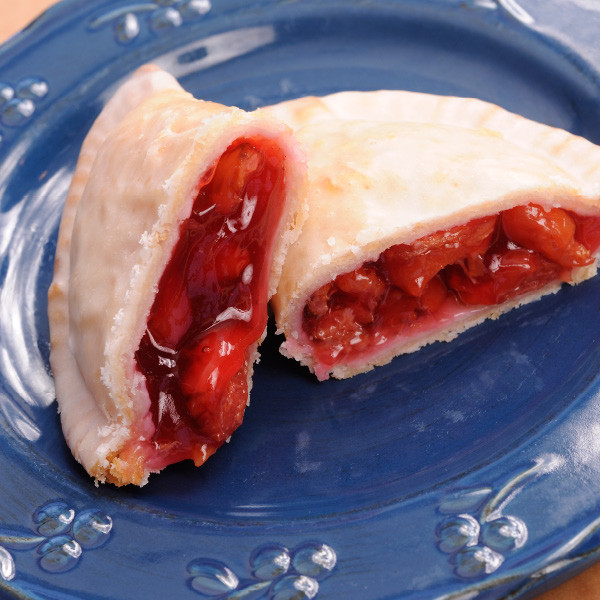 A pie you can hold in your hand, our delicious Amish fry pies are similiar to a turnover or Amish half-moon pies. Made with our own pie filling and homemade dough, the pastries are fried then sealed with a sweet vanilla-flavored glaze. Each pie is 8oz (larger than many commercial fry pies). All options are available with or without additional cream cheese filling. Baked and shipped from Ohio's Amish Country.  Available as a half dozen of one flavor.