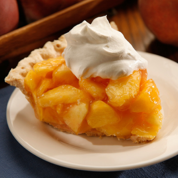 """The Taste of the Summer...all wrapped up in one refreshingly delicious pie. One of our most popular pies, this is the same fresh peach pie as we serve in our Der Dutchman, Dutch Valley, Dutch Kitchen and Berlin Farmstead restaurants. It features fresh uncooked peaches sliced into our own homemade peach glaze. Whenever possible, we use juiciest fresh-picked local Ohio peaches for the best flavor. No baking is required!  Kit includes:      One 9"""" pre-baked pie shel     Peach pie filling made with fresh peaches     Whipped cream"""