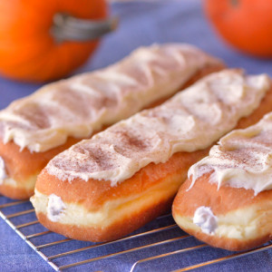 Special for the Fall season, enjoy the unique treat of our Pumpkin Long Johns!  One of the most popular items in our bakeries, our Amish creamsticks (also known as eclairs or long johns) are a rich decadent treat. At approximately seven inches long, our homemade creamsticks will dwarf most commercial bakeries' pastries. Our Pumpkin creamsticks (and all our bakery pastries) are fried in trans-fat free soybean oil then filled liberally with a mild fluffy pumpkin cream. Frosted with Pumpkin-flavored icing. Baked and shipped from Ohio's Amish Country.  Comes as a half-dozen creamsticks and will ship un-iced for easier transit. Frosting will come packaged separately.