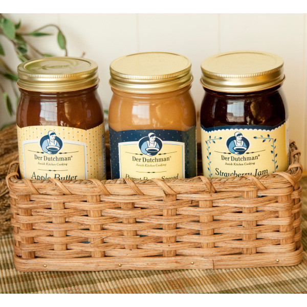 The three 16 oz. jars of Der Dutchman Apple Butter, Amish Peanut Butter spread and Jam settle nicely into this hand-crafted cracker basket. Amish-made and signed by a Fredericksburg, Ohio family of basket-makers, this cracker basket could be lined with a colorful cloth for serving cookies or crackers later.