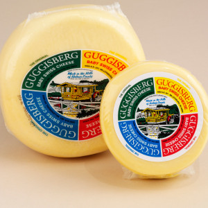 """A delicious semi-soft cheese with a buttery, subtly sweet flavor. Made with whole milk, its shorter curing time results in smaller """"eyes"""" and a milder nature than traditional Swiss cheese. An excellent choice for snacks, appetizers, sandwiches, fondues and recipes."""