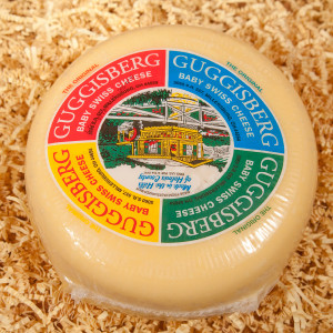 """Guggisberg Baby Swiss Cheese is the most popular cheese sold here in Amish Country. A delicious semi-soft cheese with a buttery, subtly sweet flavor. Made with whole milk, its shorter curing time results in smaller """"eyes"""" and a milder nature than traditional Swiss cheese. An excellent choice for snacks, appetizers, sandwiches, fondues and recipes.  4lb Guggisberg Baby Swiss Cheese"""